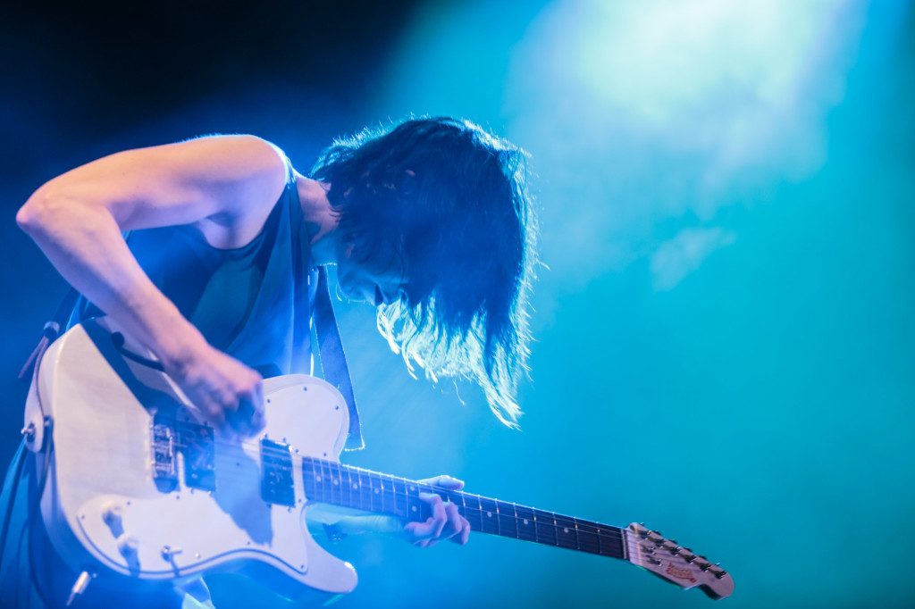 Carrie Brownstein of Sleater-Kinney plays guitar at Pitchfork Music Festival in Chicago in July 2015. Photo by Ben Stas